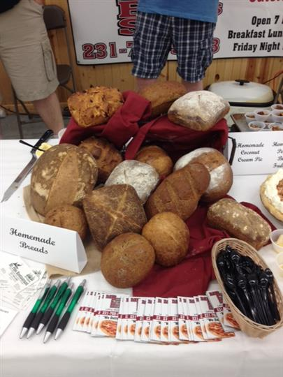 Homemade breads on a table with pens and menus in front of it.