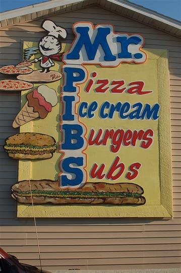 Sign for Mr. Pibs on the side of the restaurant