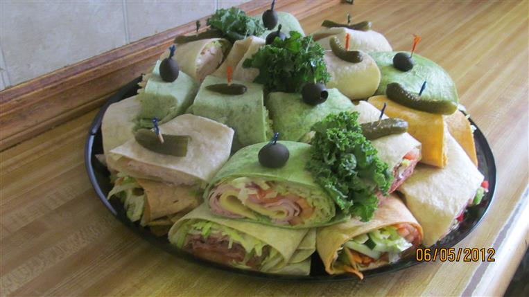 deli sandwiches on a tray