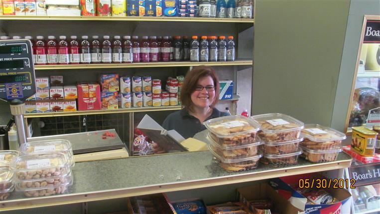 employee behind the counter smiling
