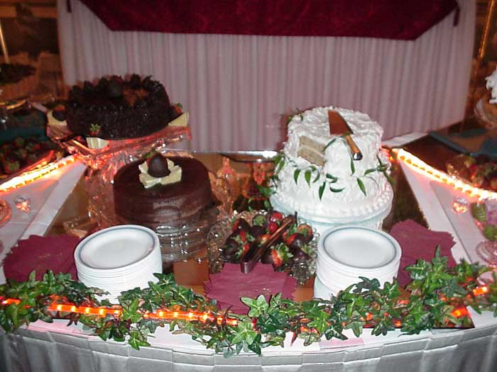 three cakes on a serving table