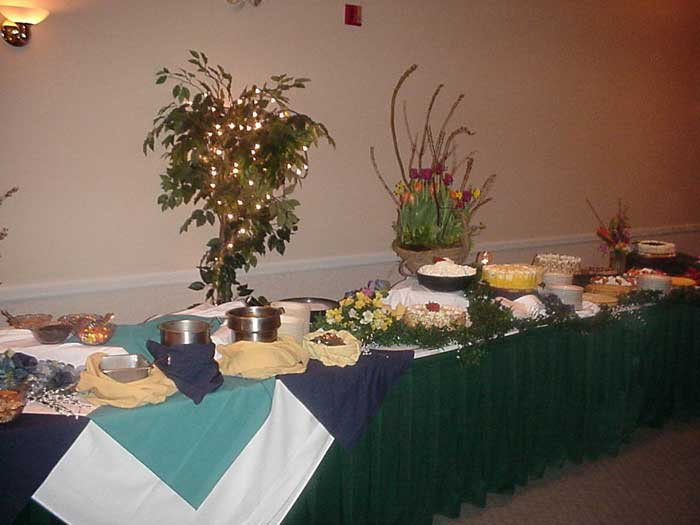 buffet table with various food dishes