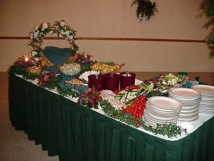buffet table with various salads