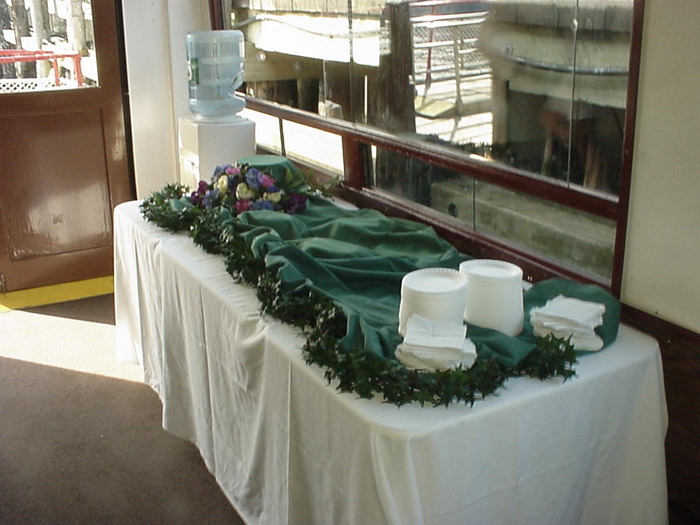 a decorated serving table with plates and napkins