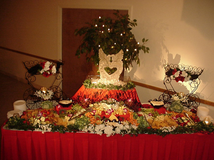 serving table with various fruits and vegetables