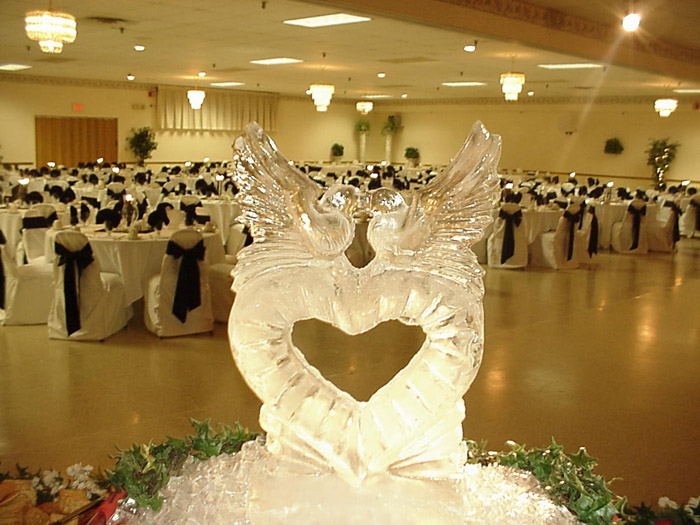 ice sculpture carved as a heart with two kissing doves