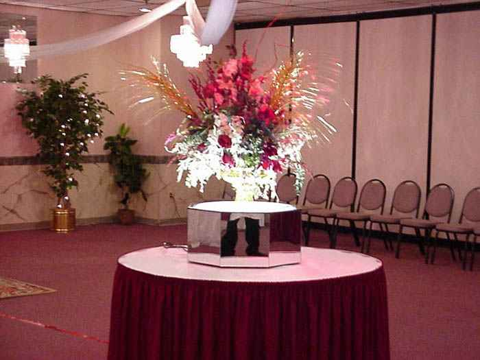 a table with a floral centerpiece