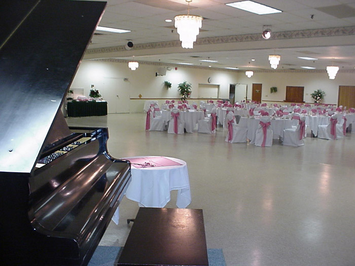 catering hall with large piano and tables