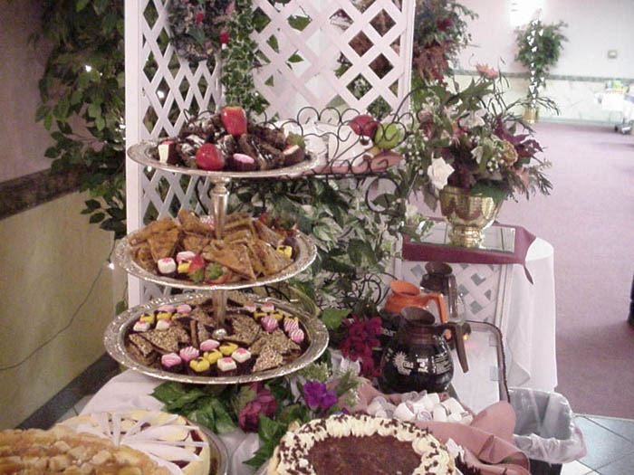 a dessert spread with various pastries