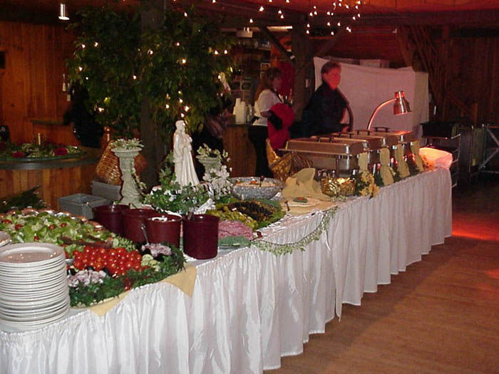serving table with vegetables spreads and several serving trays