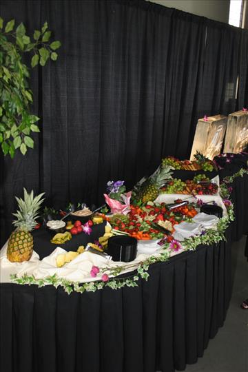 a large spread of fruits and vegetables on a serving table