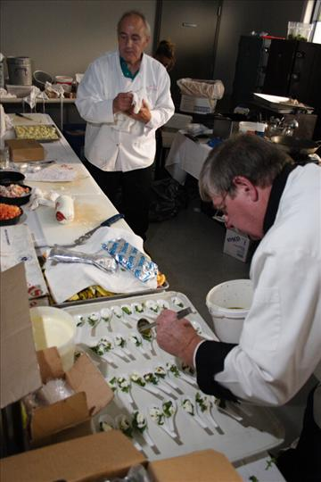 a chef decoratively preparing food
