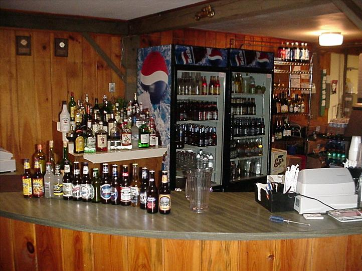 the bar, with a large assortment of alchoholic beverages