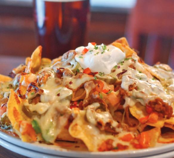 nachos topped with a variety of ingredients