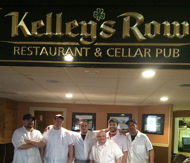 employees posing for picture
