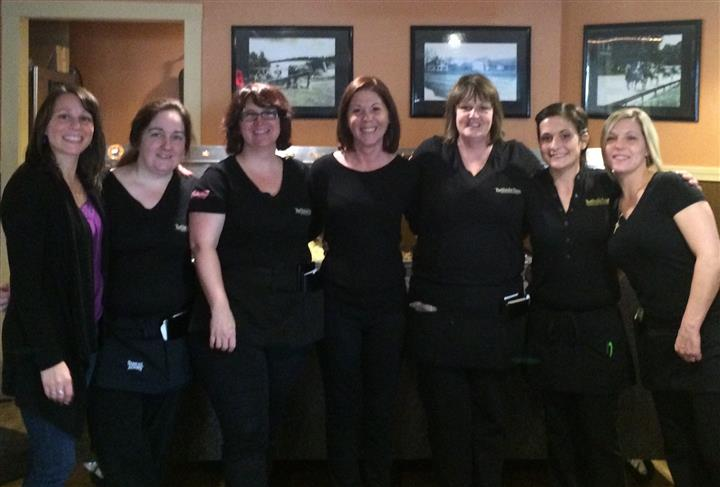 employees smiling for picture