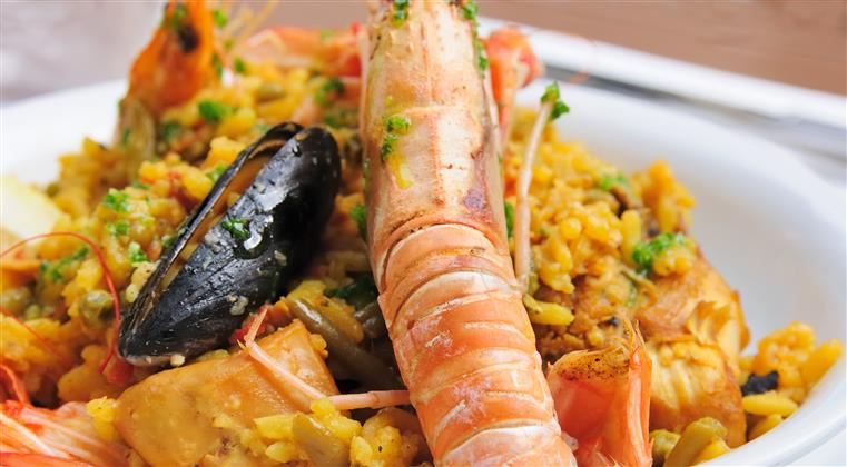 large shrimp and mussels tossed in a seasoned rice.