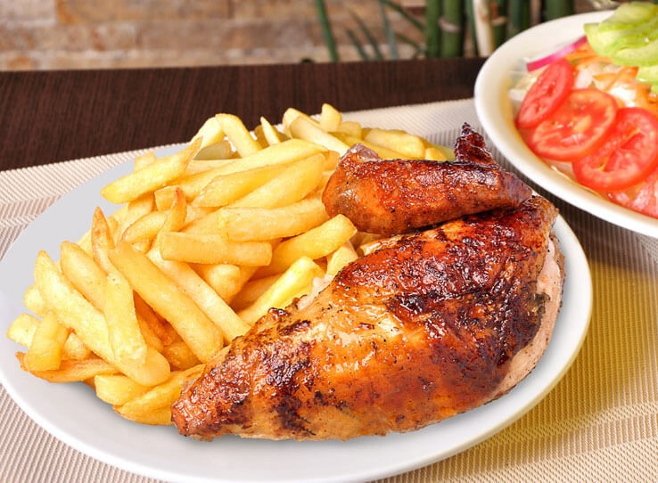 roasted chicken leg with french fries