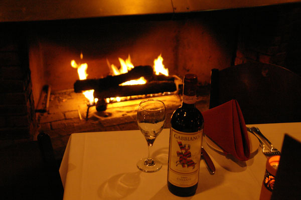 Wine and wine glass by the fire place