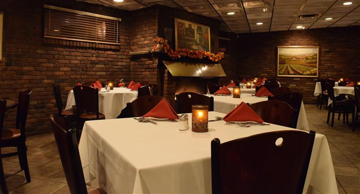 Dining area of restaurant with uniformly folded napkins