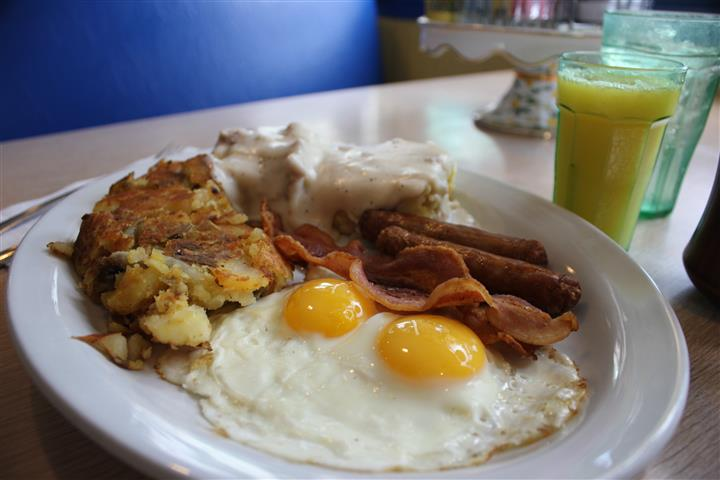 The historic downtown Oviedo plate served with home fries and a glass of orange juice