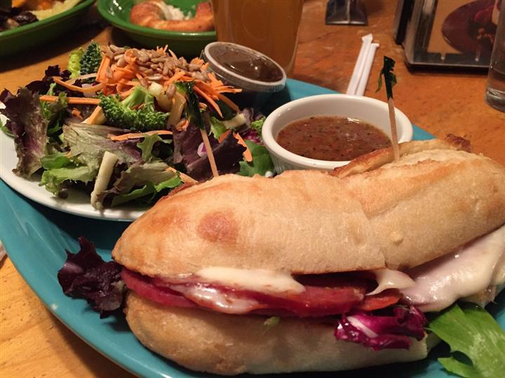 Hoagie with salad and multiple dressings