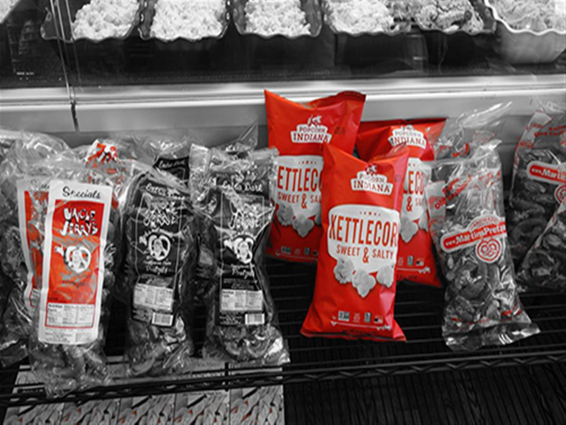 assortment of bags of chips