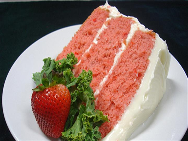 Cake with a Strawberry on the side