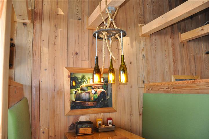 Dining area with wine bottle chandeliers