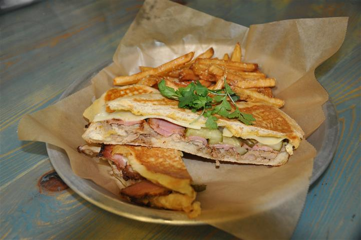 Sandwich with ham, pickles, cheese, side of fries