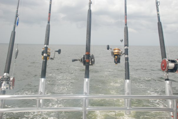 Three fishing poles on the boat