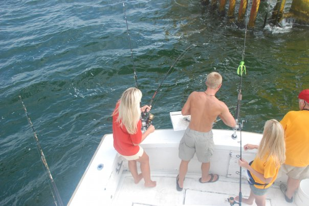 A couple on a boat fishing