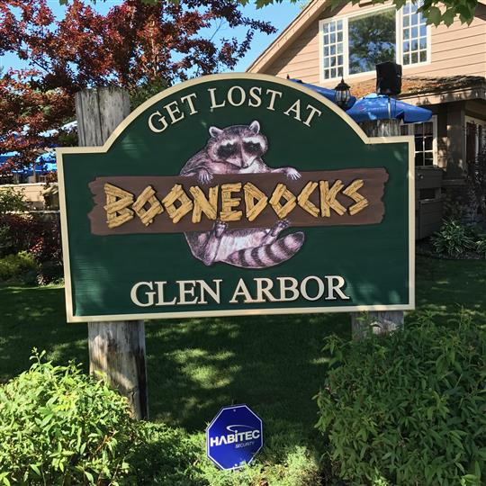 Boonedocks Sign on lawn with establishment in the background