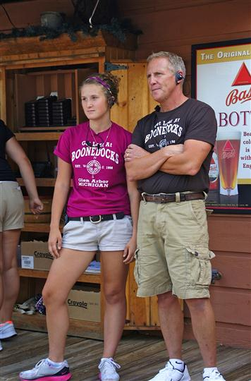 A man and a women wearing a Boonedocks T-Shirts