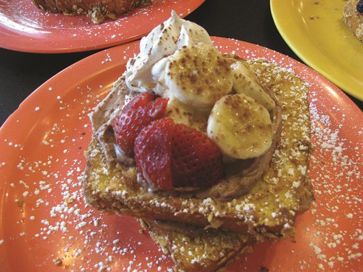 french toast topped with bananas and strawberries