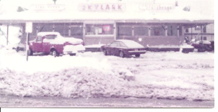Parking lot of Skylark with snow on the ground