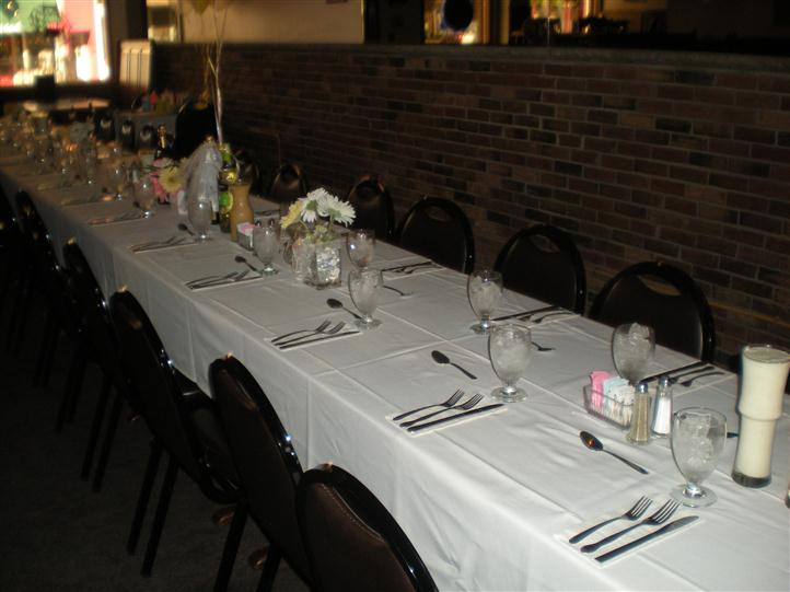 Table set up for a party. utensils set up in a uniform manner