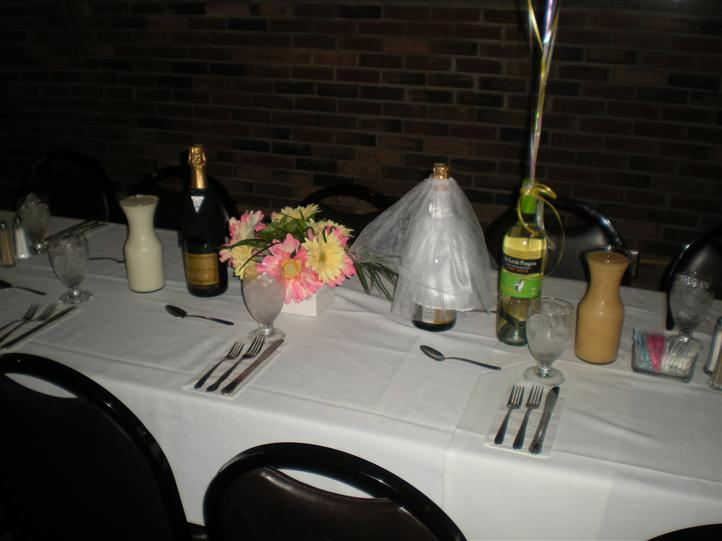 Groom and bride themed table decor for a wedding