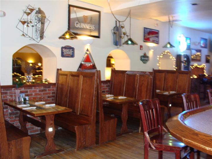 Dining area with framed beer signs on the wall