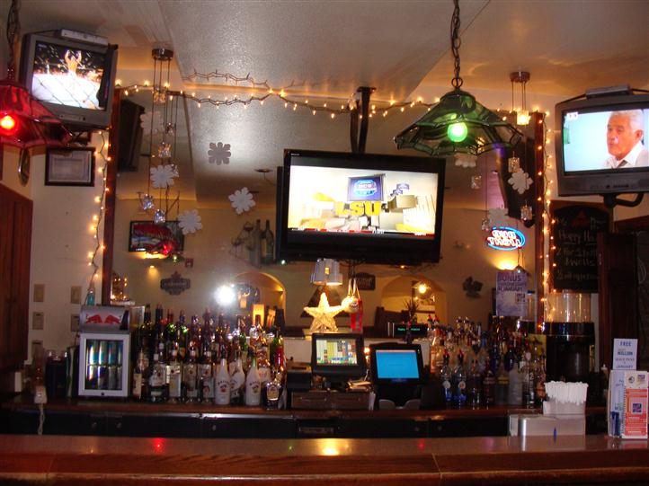 Bar area of establishment with Tv in the background