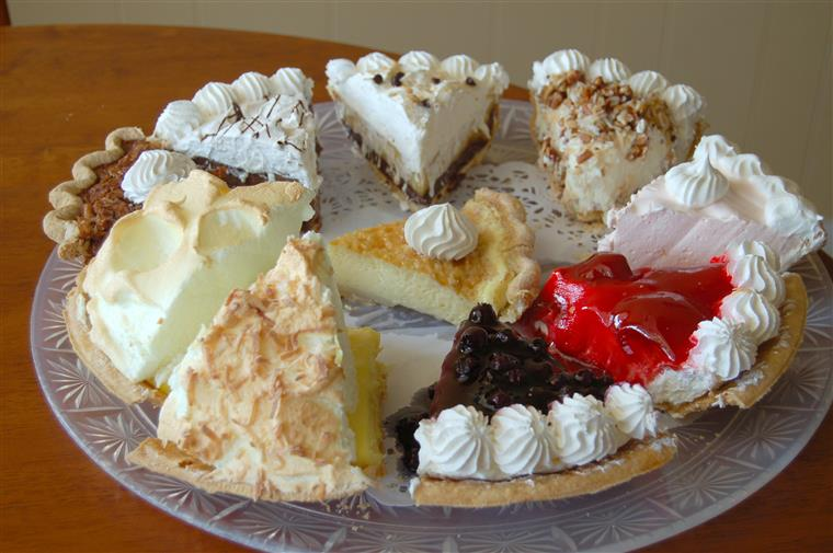 Assorted slices of pie on clear dish.