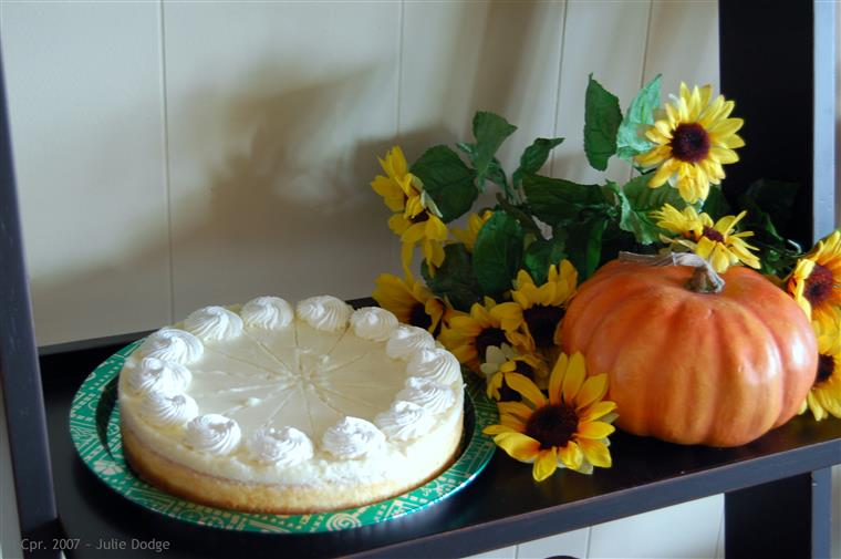 Pie and fall decorations on black shelf