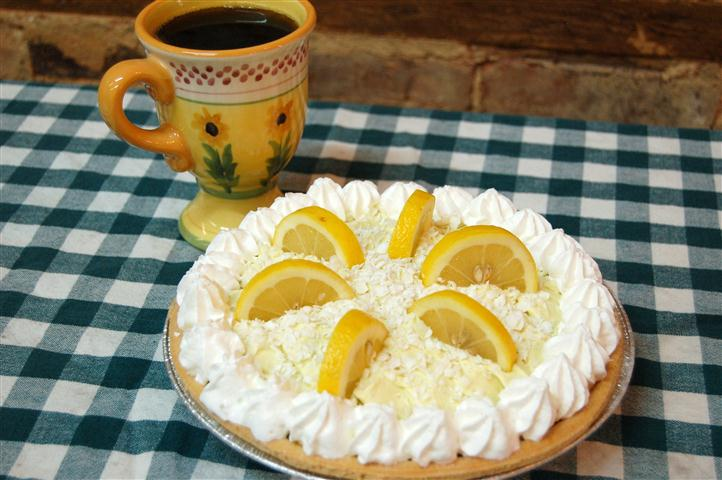 Lemon Meringue pie topped with lemon slices.