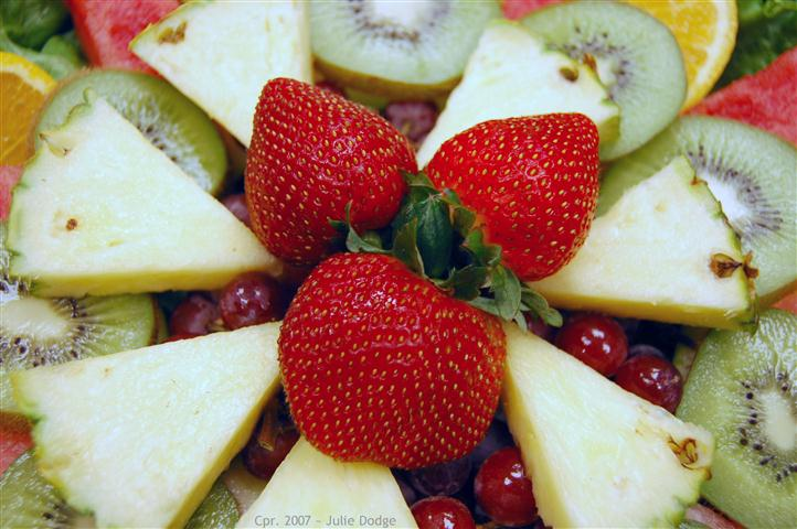 Close up of fruit platter with kiwi, strawberries and pineapple.