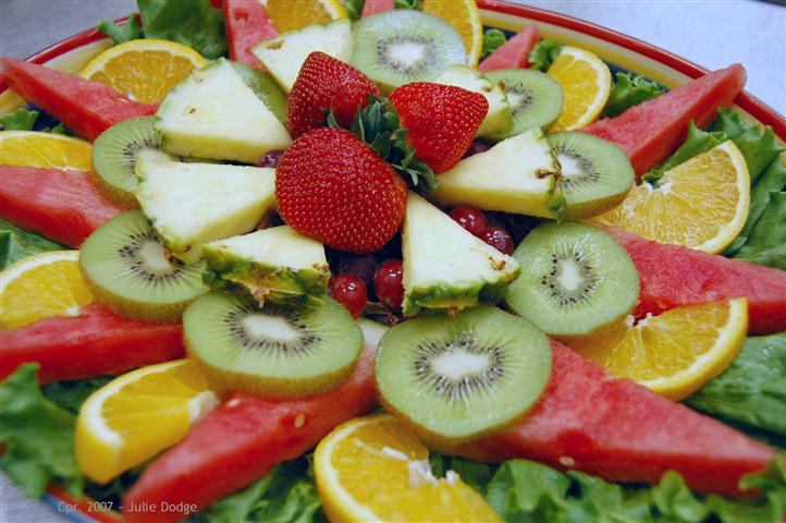 Fruit platter with oranges, watermelon, pineapple, kiwi and strawberries.