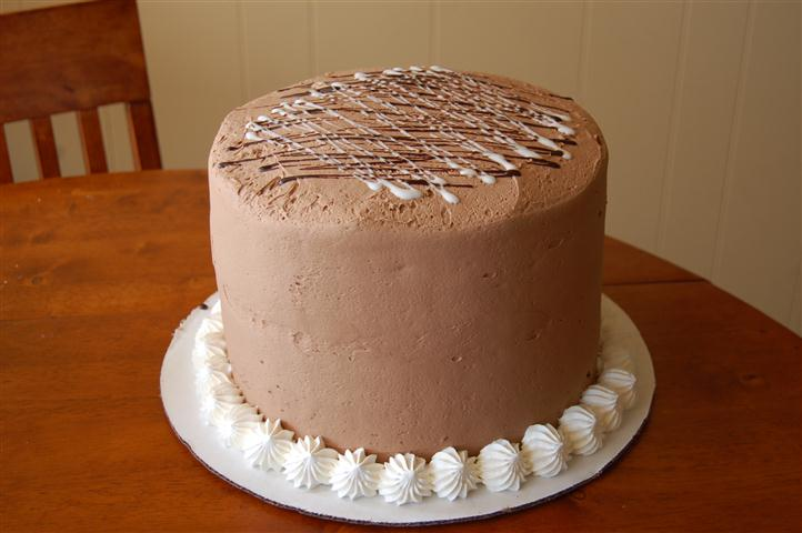 Tall cake with chocolate frosting.