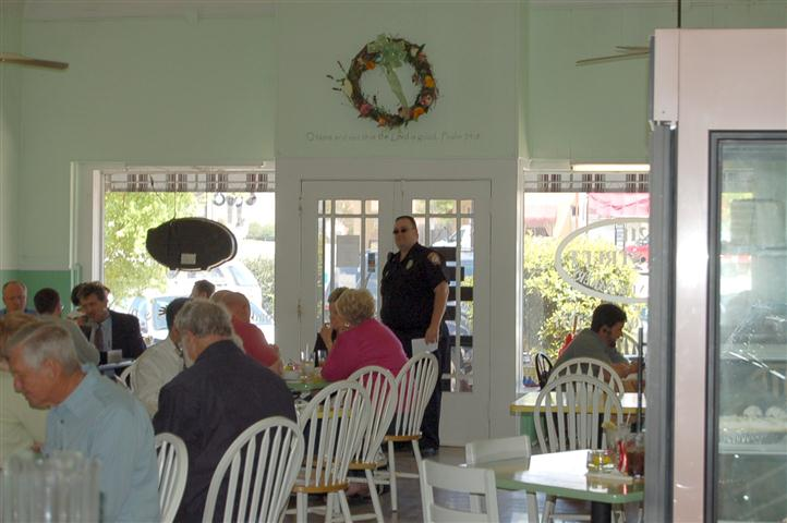 Inside view of restaurant with tables filled with customers.
