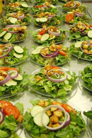 table full of salad bowls.