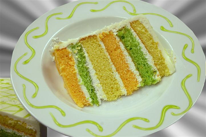 6 Layer cake with green, yellow and orange layers.