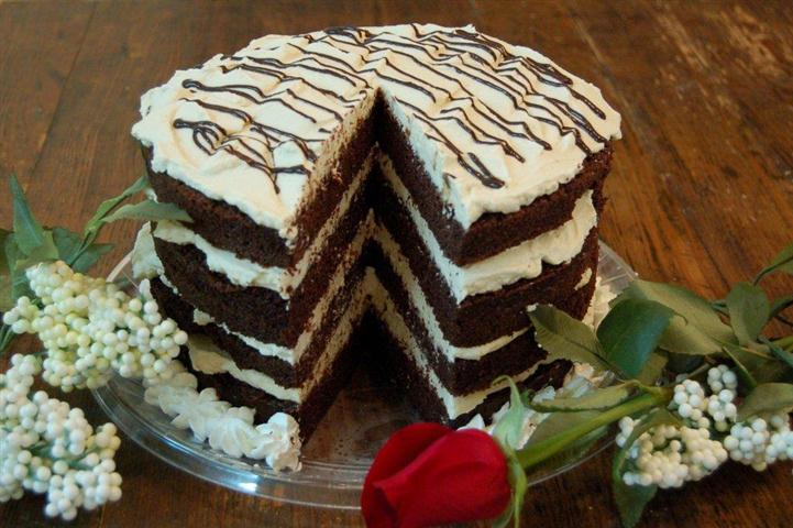Four layer chocolate cake with vanilla cream layers in between.